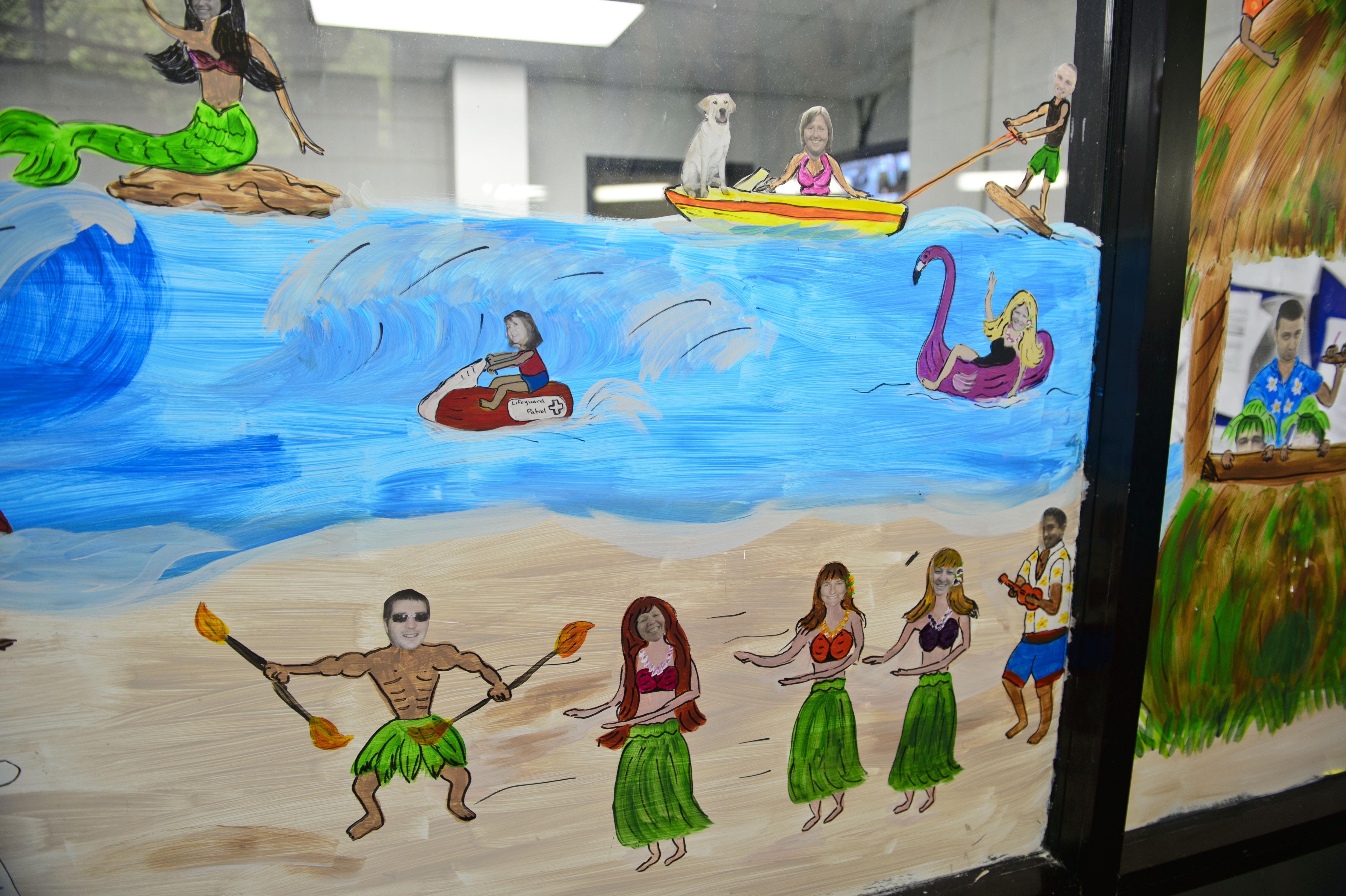 murals spread smiles at providence recenter our stories and providence staff were painted in a beach scene for colon s summer mural