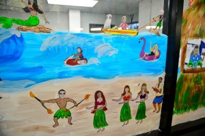 Providence staff were painted in a beach scene for Colón's summer mural.