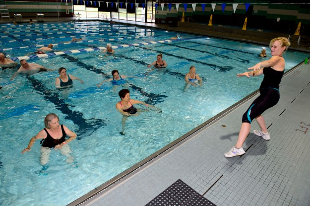 Seniors get exercise and catch up with friends during a water aerobics for arthritis at South Run RECenter.