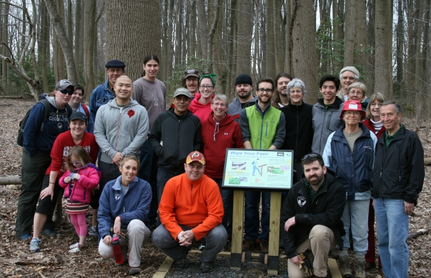 Employees from REI (Recreation Equipment, Inc.) stores in Fairfax and Tysons joined Invasive Management Area (IMA) program site leaders and Fairfax County Park Authority staff at Nottoway Park on April 2, 2014, to mark the start of the Park Authority's Take Back the Forest initiative.