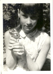A young Suzanne Holland holds Baby Rabbity.