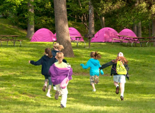 Girl Scouts return to their tents during an overnight at Riverbend.